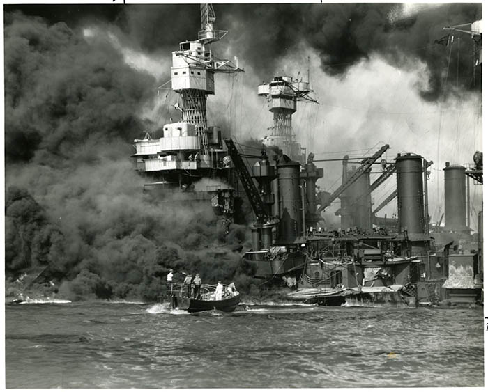 Crew rescuing men of the USS <em>West Virginia</em> during the attack on Pearl Harbor, December 7, 1941.
