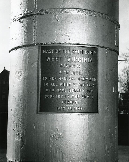 Dedication plaque on the mast of the USS <em>West Virginia</em> on the campus of West Virginia University.