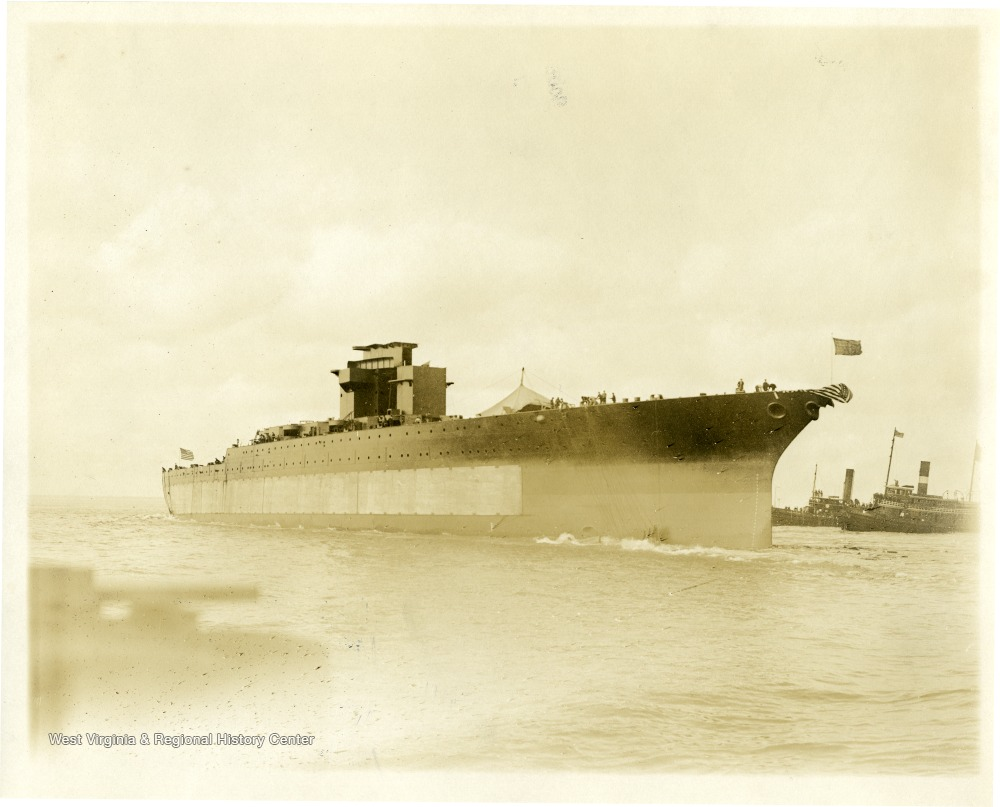 The U.S.S. West Virginia floats out into Hampton Roads after being launched at the Newport News shipyard. Afterwards she was outfitted and commissioned in 1923.