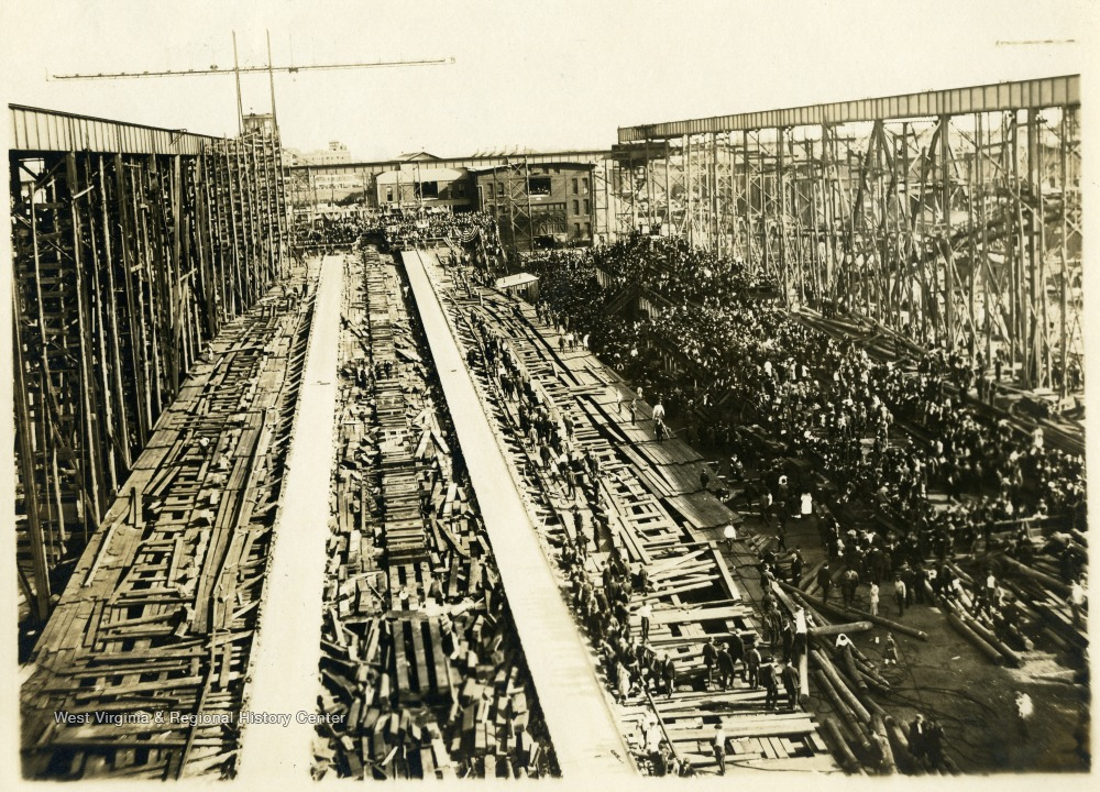 A crowd disperses after the launching of the battleship.
