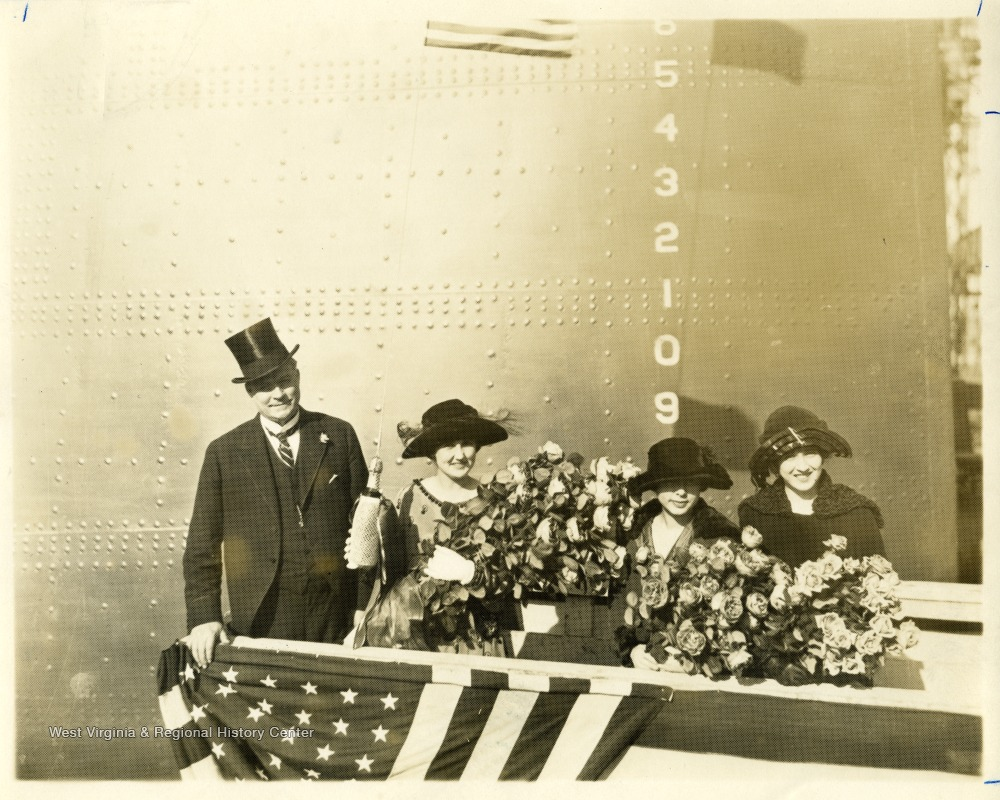 Group portrait of Governor Ephraim Morgan, Alice Wright Mann and others ladies holding bouquets before the christening of the U.S.S. West Virginia.