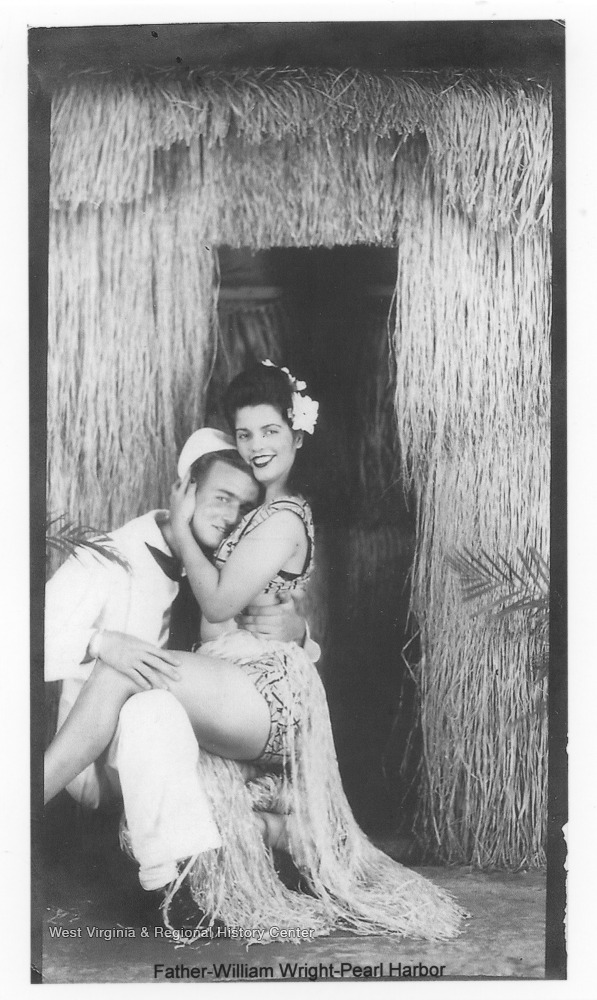 Wright, left, is pictured with an unidentified woman on his lap. Photos are from an album belonging to a member of the U.S.S. West Virginia.  William Wright, Radio Technician 2C, was on the ship from 1944-45 and saw action at Leyte Gulf, Iwo Jima, and Okinawa.