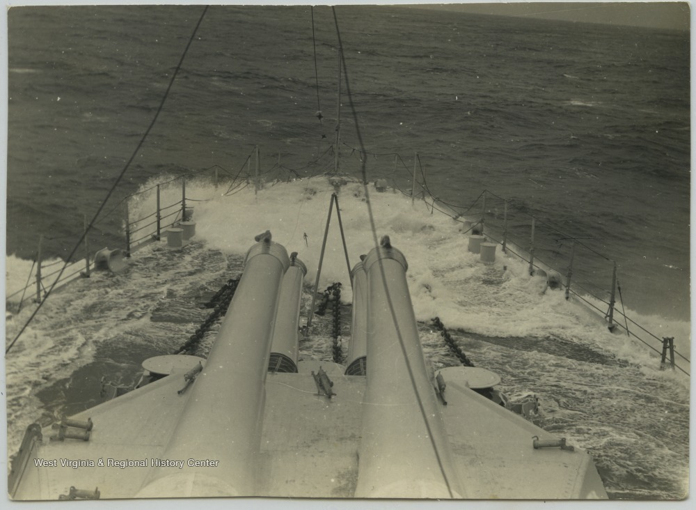 The battleship's deck is briefly flooded by seawater.