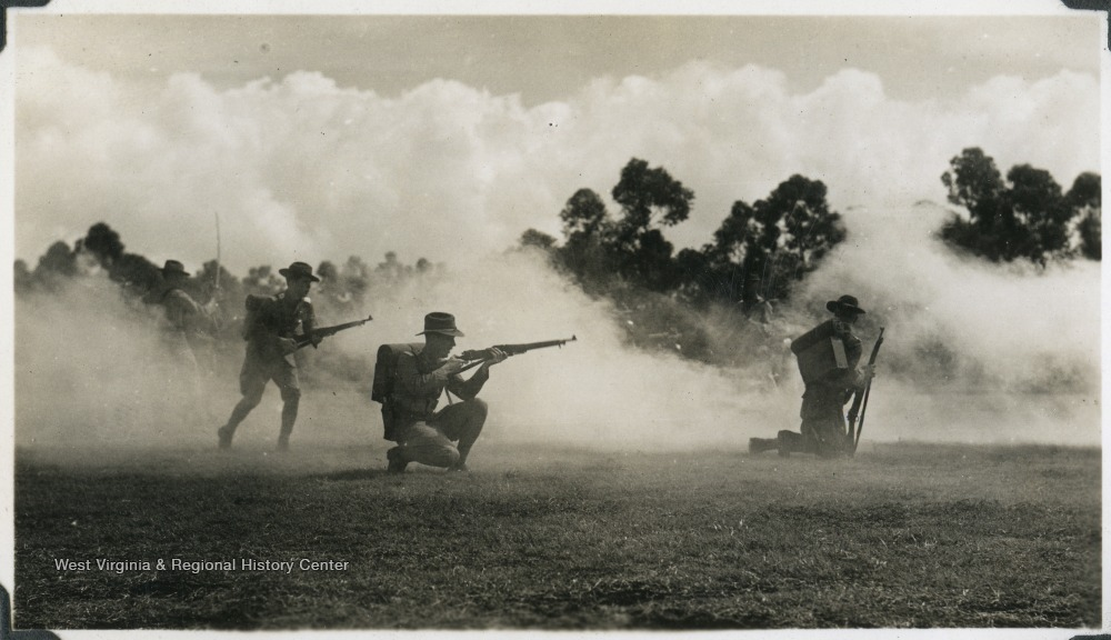 A group of soldiers practice firing. Photograph comes from a U.S.S. West Virginia scrapbook.