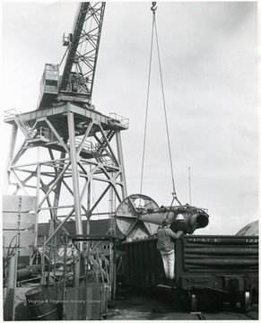 Mast of U.S.S. West Virginia being loaded at Todd Shipyards in Seattle, Washington for shipment to Morgantown in February 1961.