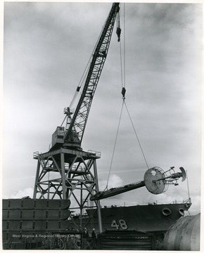 The mast of the U.S.S. West Virginia being loaded at Todd Shipyards in Seattle, Washington. The mast was shipped to Morgantown, W. Va. in February 1961.