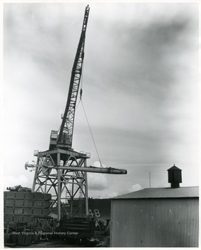The mast of the U.S.S. West Virginia being loaded at Todd Shipyards in Seattle, Washington. The mast was shipped to Morgantown, West Virginia in February 1961.