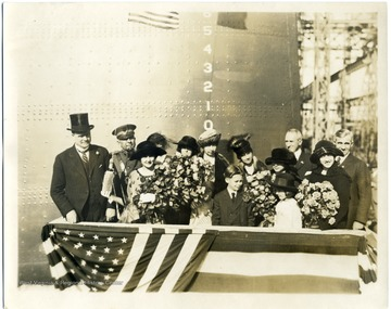 Group portrait of Governor Ephraim Franklin Morgan, Alice Wright Mann, and others at the christening of the U.S.S. West Virginia.