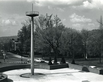 A view of Memorial Plaza looking down south on University Avenue.  Mast belongs to battleship West Virginia which was sunk at Pearl Harbor.