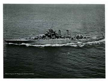 An aerial view of U.S.S. West Virginia (BB-48), broad on beam.