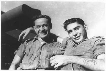 Two sailors pose together for a photo. The man on the right is likely named Al. Photos are from an album belonging to a member of the U.S.S. West Virginia.  William Wright, Radio Technician 2C, was on the ship from 1944-45 and saw action at Leyte Gulf, Iwo Jima, and Okinawa.