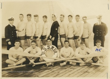 Whale boat crew that won a race near San Pedro, California, on February 4, 1934 with a time of 16 minutes, 7 seconds.  William Hand is identified as front row, far right.