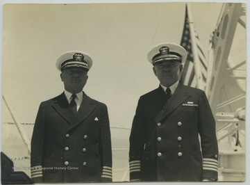The old captain of the ship, William R. Furlong (right), stands beside the new captain of the ship, William O. Spears (left).