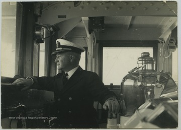 Captain William Furlong peers out at the navigation bridge during a U.S.S. West Virginia voyage.