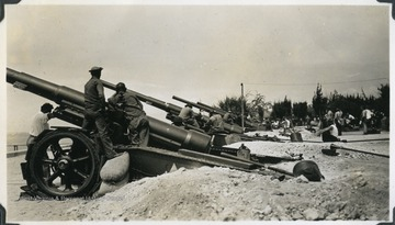 American military work with coastal artillery during a defense campaign. Photograph comes from a U.S.S. West Virginia scrapbook.