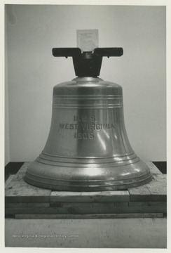 Bell of the U.S.S. West Virginia before installation on the campus of West Virginia University.  The bell was dedicated on December 7, 1967, and joined the mast of the U.S.S. West Virginia in Memorial Plaza.
